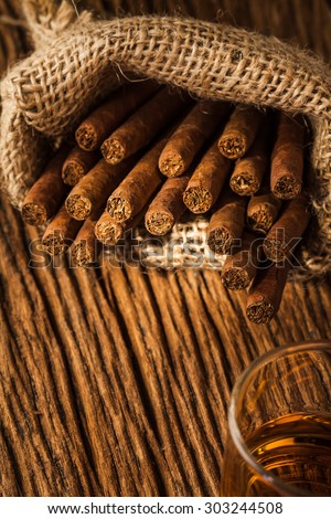 cigar in small sack on the old wooden table