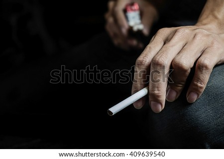 Cigarette addiction. Tobacco nicotine smoke. Unhealthy, danger, bad, narcotic habit. White filter. Health risk, cancer illness. Quit, stop toxic drug. Lifestyle concept. Pack in hand - stock photo
