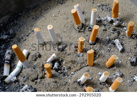 cigarette after smoke in ashtray - stock photo