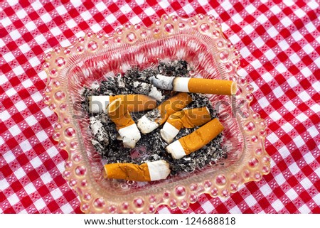 cigarette and ashtray - stock photo