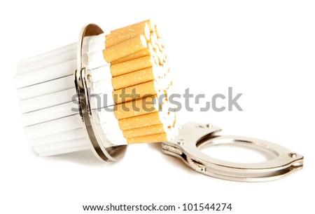 Cigarette  and  handcuffs - stock photo
