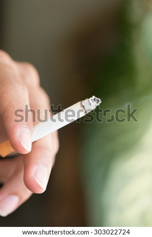 cigarette and smoke on hand