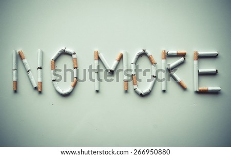 Cigarette arranged as a word no more - stock photo