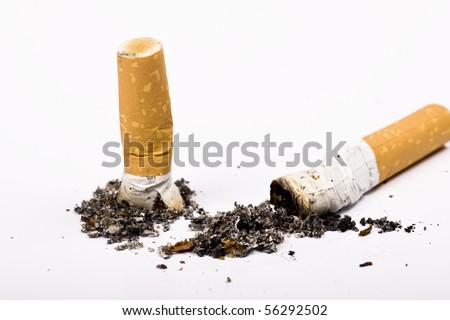 Cigarette butt and ash macro closeup, isolated - stock photo