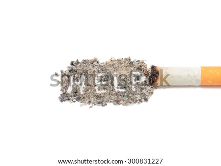 Cigarette butt and ashes. Quit smoking now. Isolated on white background