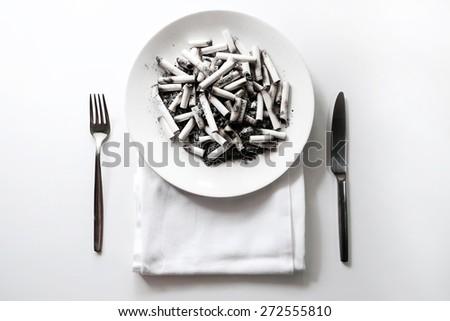 Cigarette butt in plate,Anti-smoking campaign concept  - stock photo