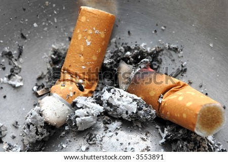 Cigarette butt in the ashtray,  unhealthy life style concept - stock photo