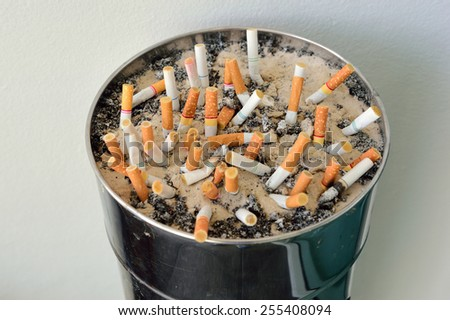 Cigarette butts and ashtrays - stock photo