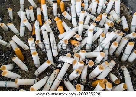 Cigarette butts at ashtray  - stock photo