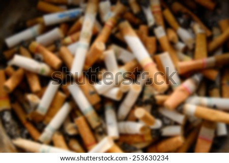 Cigarette butts blur - stock photo