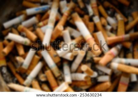 Cigarette butts blur - stock photo