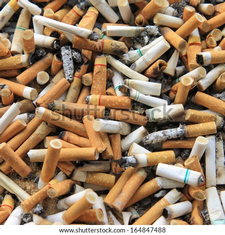 Cigarette butts stacked - stock photo