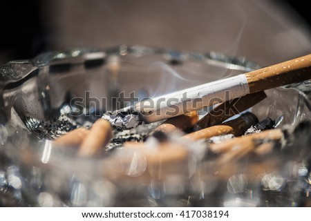 Cigarette in an ashtray - stock photo