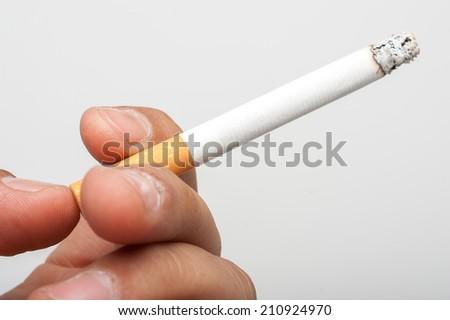 Cigarette in hand - stock photo