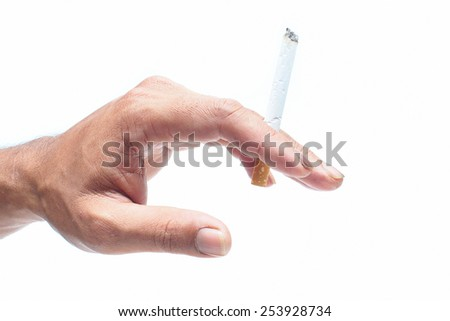 Cigarette in hand on white background. - stock photo