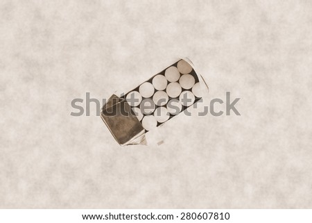 Cigarette in paper box packaging with old scenic appearance represent the tobacco concept related idea. - stock photo