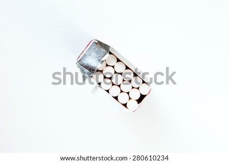 Cigarette in paper box packaging with represent the tobacco concept related idea. - stock photo