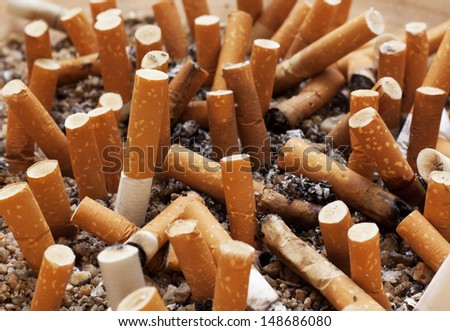 Cigarette in the ashtray.