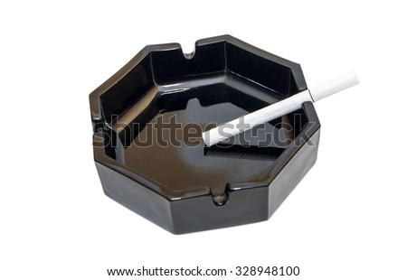 cigarette in the ashtray on a white background - stock photo