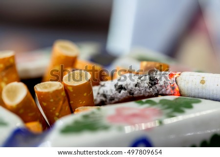 Cigarette on brown background