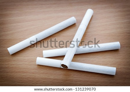 Cigarette on desk - stock photo