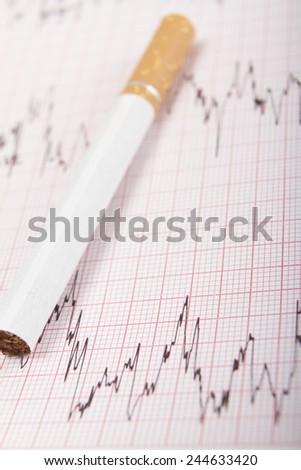 Cigarette On ECG Printout - stock photo