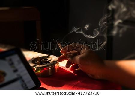 Cigarette on stainless ashtray. on morning light. - stock photo