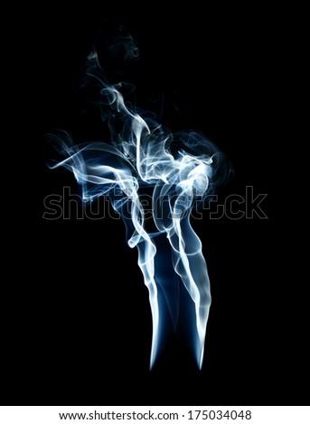 cigarette smoke on black background  - stock photo