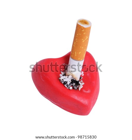 Cigarette stub in heart isolated on a white - stock photo