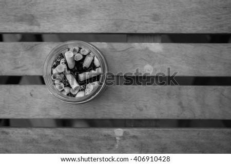 Cigarette Stub in the small glass - stock photo