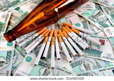 Cigarettes and Bottle of the Beer on the Russian Currency Background