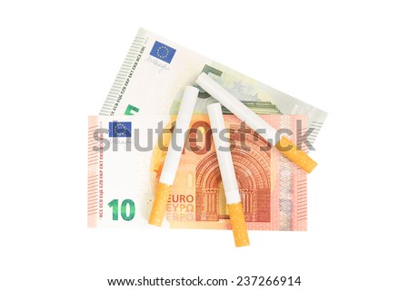 Cigarettes and euro banknotes as a concept of smoking costs - stock photo