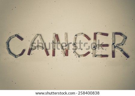 cigarettes arranged as a word cancer - stop smoking concept - stock photo