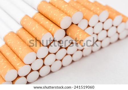 cigarettes closeup on white background - stock photo