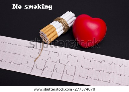 Cigarettes dynamite and heart on ECG Printout on a black background  - stock photo