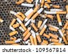 Cigarettes in a big iron ashtray - stock photo