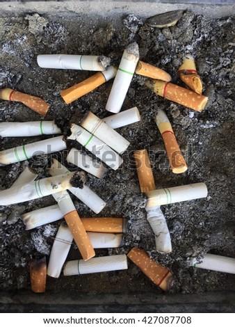 Cigarettes in the ashtray background  - stock photo