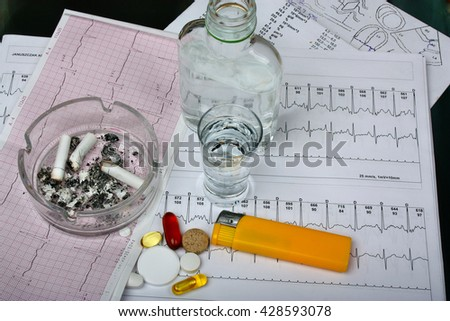 Cigarettes in the ashtray, vodka on the table of medical research, tablets