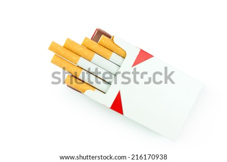 Cigarettes in the cigarette box over white background - stock photo