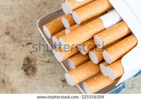 Cigarettes sticking out from the pack. Close-up view - stock photo