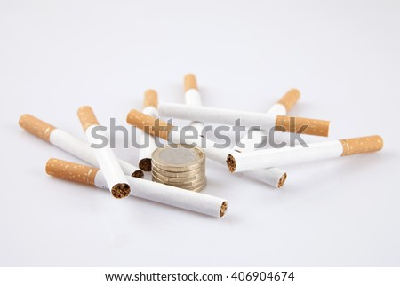 cigarettes with money on white