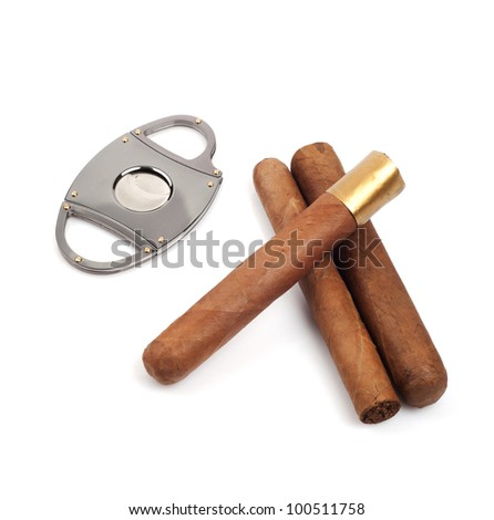 Cigars and a cutter isolated on white background