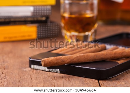cigars and whisky on old wooden table