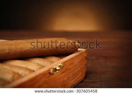 Cigars in humidor on wooden table, closeup - stock photo