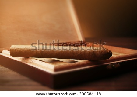 Cigars on wooden table, closeup - stock photo