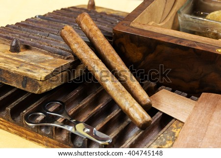 Cigars with wooden box, and tools for cigar preparation