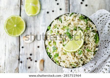 cilantro lime garlic brown rice. the toning. selective focus - stock photo