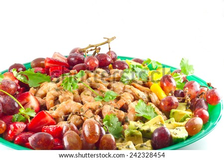 Cilantro marinated shrimp and fruit platter on a white background. - stock photo