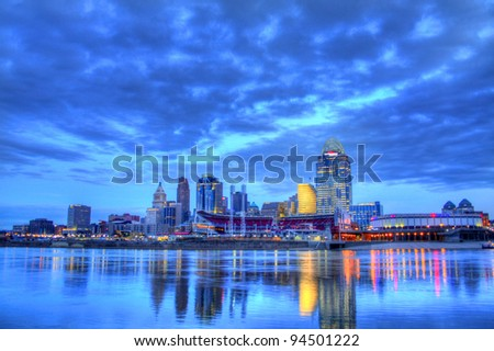 CINCINNATI – JANUARY 16: Sunrise over the skyline of Cincinnati, Ohio, January 16, 2012. Cincinnati is the third largest city in Ohio with a population of 296,943. - stock photo