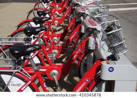 CINCINNATI, OH -20 APRIL 2016- B-Cycles are lined up in the streets of Cincinnati, Ohio. Launched in 2014, the Red Bike is a public bicycle sharing program serving Cincinnati and Northern Kentucky.